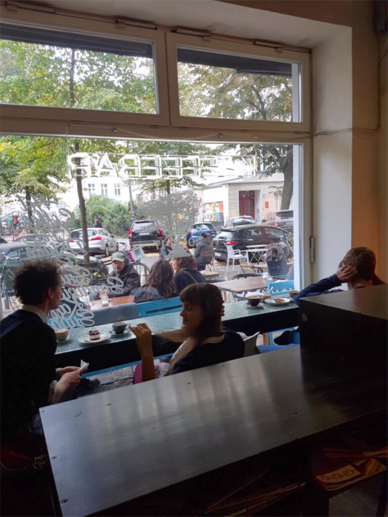 Interior view of Kaffeebar Aprilkind with guests.