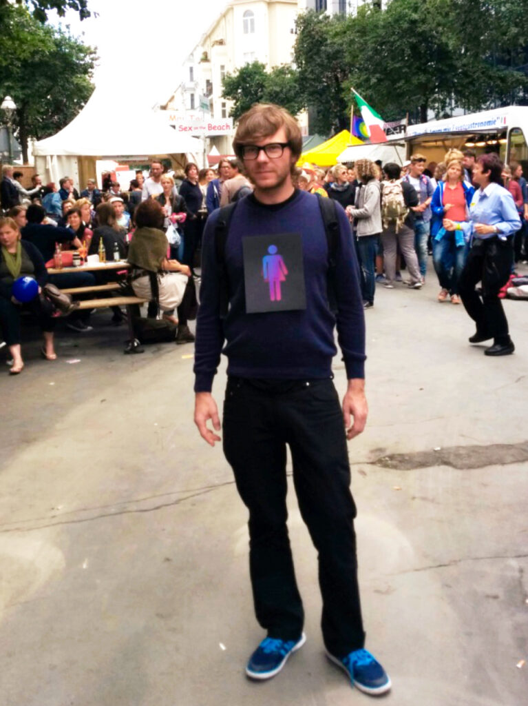 Paul Jonczyk with CO-WC sign at Lesbian and Gay City Festival in Berlin
