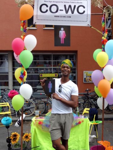 A person with a turban and the CO-WC sign at the Lesbian and Gay City Festival in Berlin.