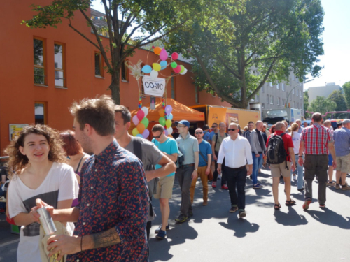 Shot from a distance of the CO-WC information booth at the Lesbian and Gay City Festival in Berlin.