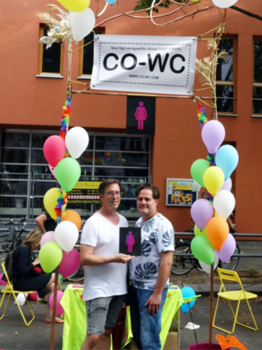 Two people at the Lesbian and Gay City Festival at the CO-WC information booth.
