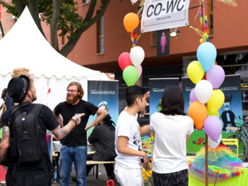 Group of people at the Lesbian and Gay City Festival at the CO-WC info booth.