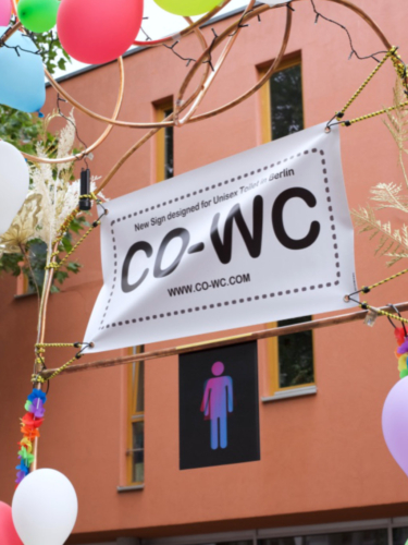 View from the side of the CO-WC poster and sign.