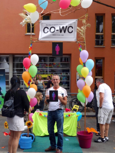 Person with CO-WC sign at the Lesbian Gay and City Festival in Berlin.