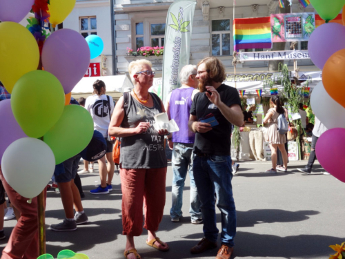 Paul Jonczyk talks to a visitor of the Lesbian and Gay City Festival in front of the CO-WC information booth.