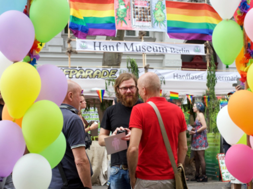 CO-WC founder Paul Jonczyk chats with two elderly people at the Lesbian and Gay City Festival.