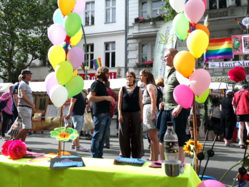 CO-WC founder Paul Jonczyk talks with two visitors at the Lesbian and Gay City Festival Berlin.