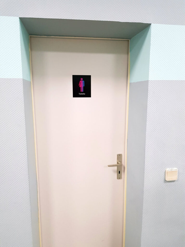 Unisex toilet with CO-WC sign.